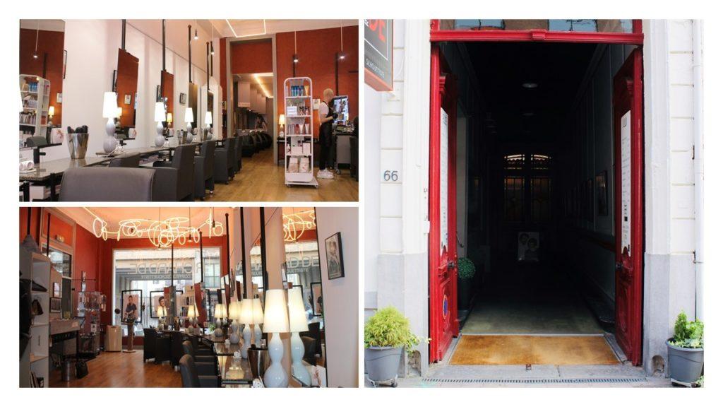 Entrée et Intérieur du salon de coiffure RIchard De, une grande porte rouge en guise d'entrée et un intérieur espacé avec de grands miroires et des lustres design